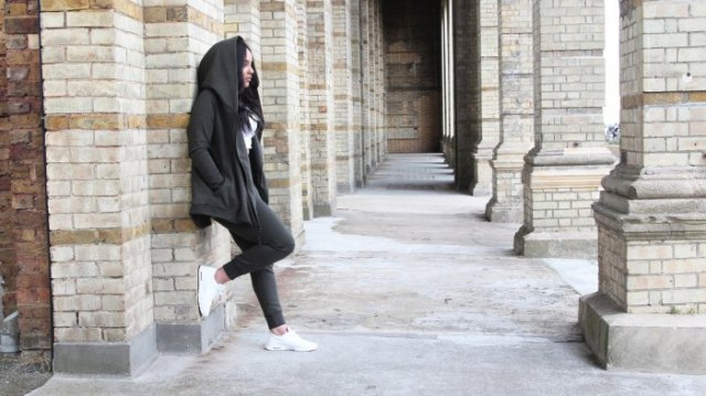 gray hoodie with matching fleece pants and white sneakers