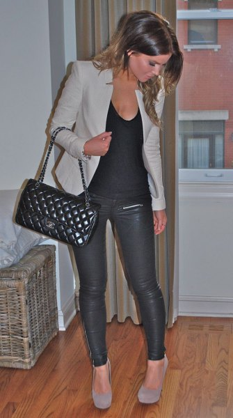 gray jacket with tank top with scoop neckline and leather pants