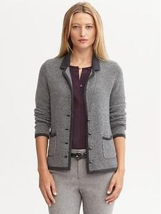 gray knitted blazer with black top and thin cotton trousers
