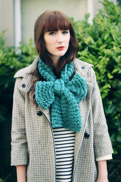 gray knitted scarf with checked trench coat