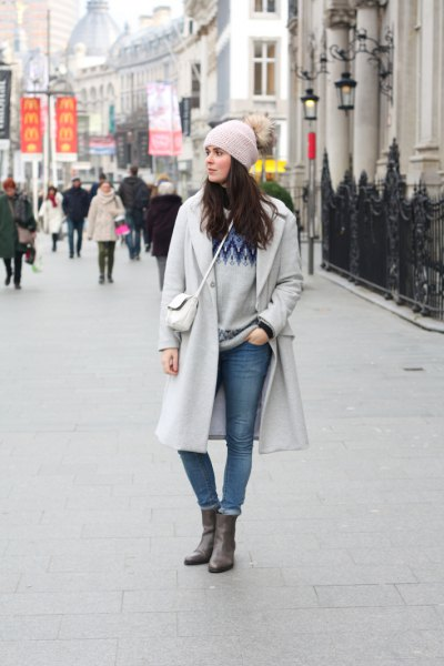 gray knitted hat and matching long winter coat and waistband jeans