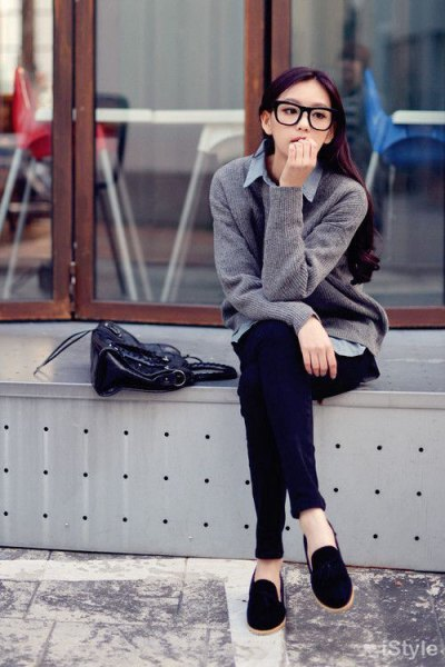 gray knitted sweater cardigan with light blue chambray shirt and black suede slippers