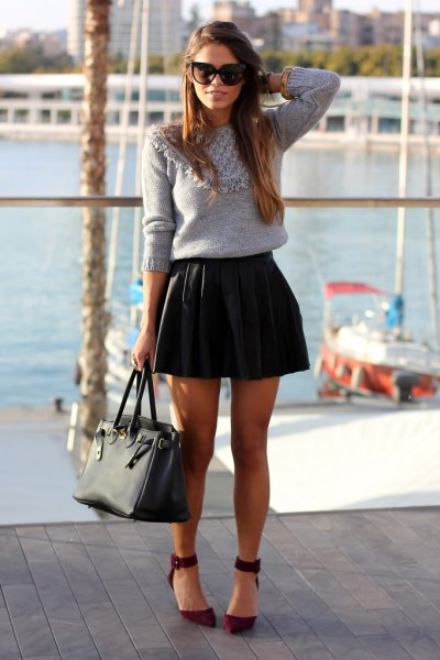 gray knitted sweater with black leather mini pleated skirt