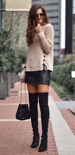 gray knitted sweater with black leather mini skirt