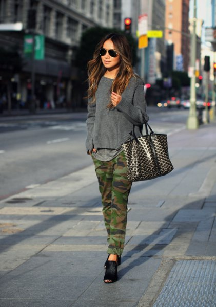 gray knitted sweater with straight leg camo jeans and black ballerinas
