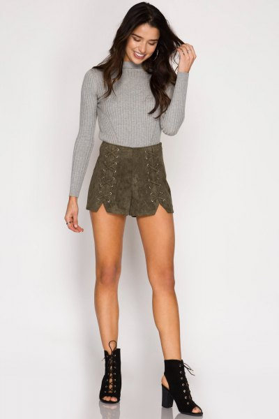 gray knitted sweater with lace-up shorts made of suede