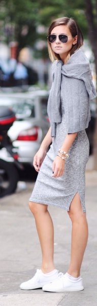 gray lace midi dress with sweater over the shoulders