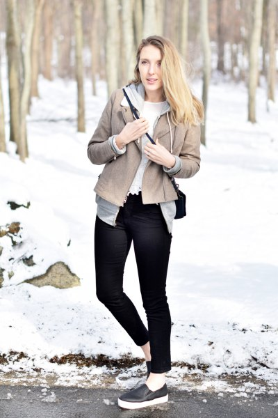 gray leather jacket with black skinny jeans and leather slip-on sneakers