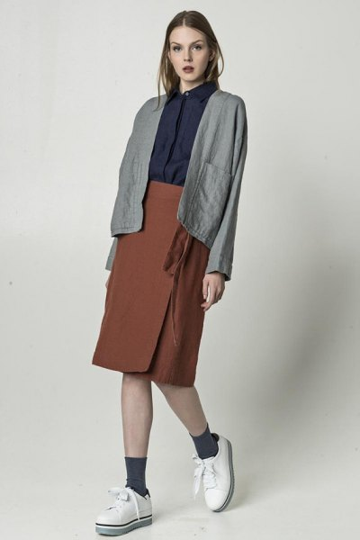 gray linen blazer with black shirt and green knee-length wrap skirt