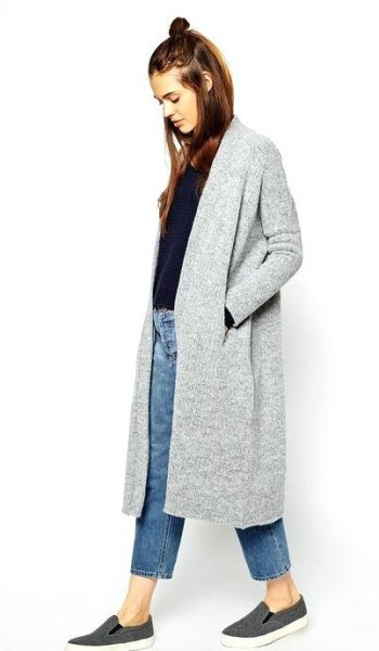 gray long cardigan with black sweater and blue ankle jeans