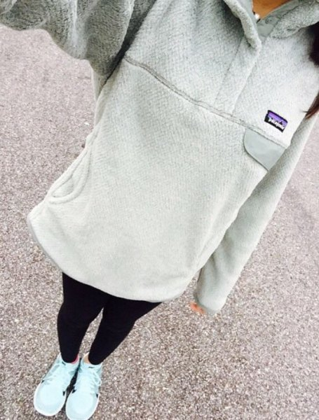 gray long hoodie with black leggings and white sneakers