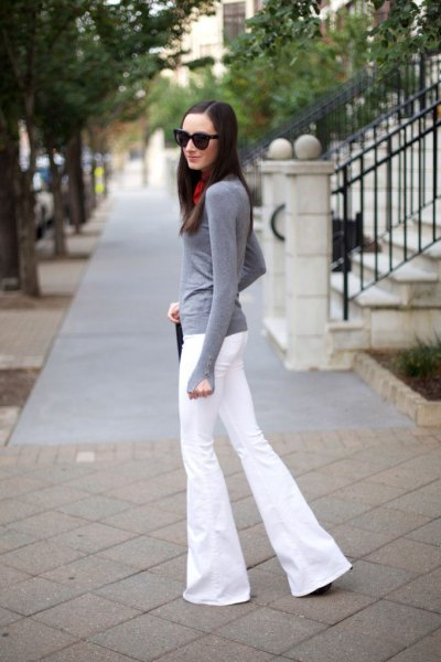 gray, long-sleeved t-shirt with white, flared jeans