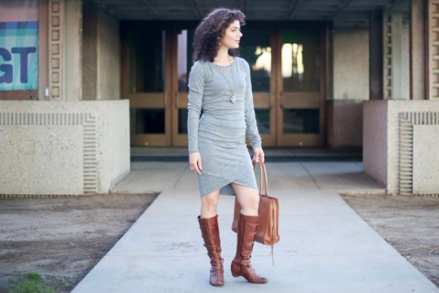 gray, long-sleeved, figure-hugging bandage dress with knee-high boots made of brown leather with side zip