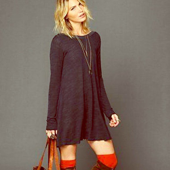 gray long-sleeved swing dress with knee-high boots made of brown suede