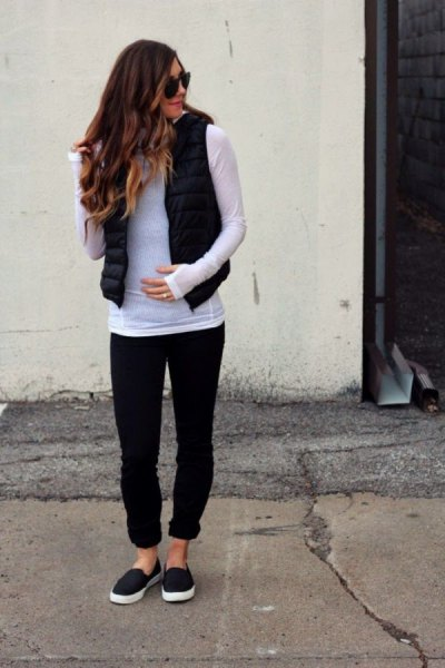 gray long-sleeved T-shirt with black puffer vest and cuffed jeans