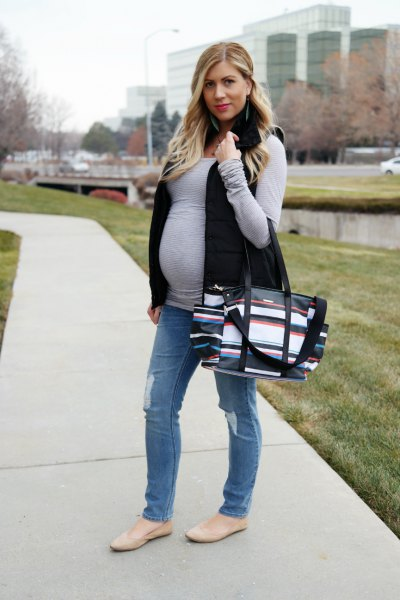 gray long sleeve t-shirt with black vest and straight leg jeans