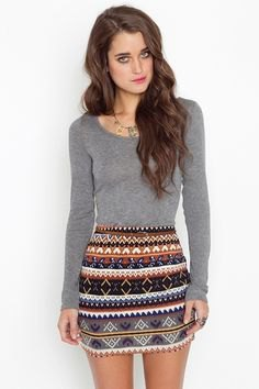 gray long-sleeved top with tribal printed mini skirt
