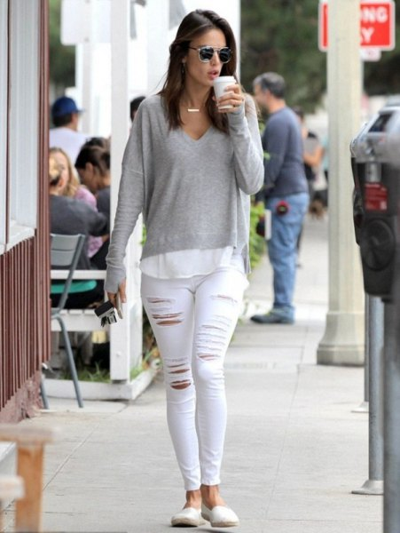 gray, long-sleeved, thin sweater with V-neck and white skinny jeans