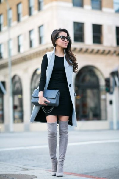 gray long sleeveless waistcoat, black shift dress
