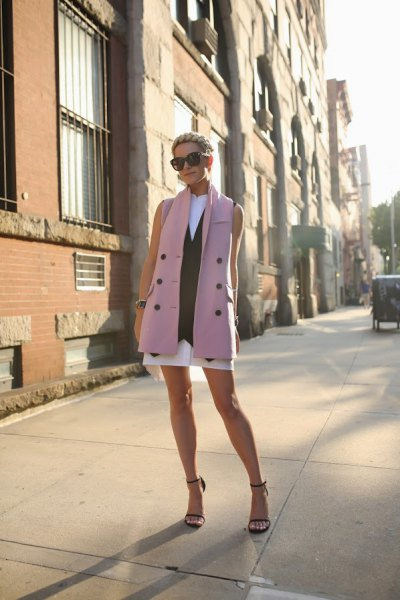 gray long suit vest with white mini dress