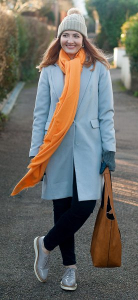 gray long wool coat with a long scarf and knitted hat
