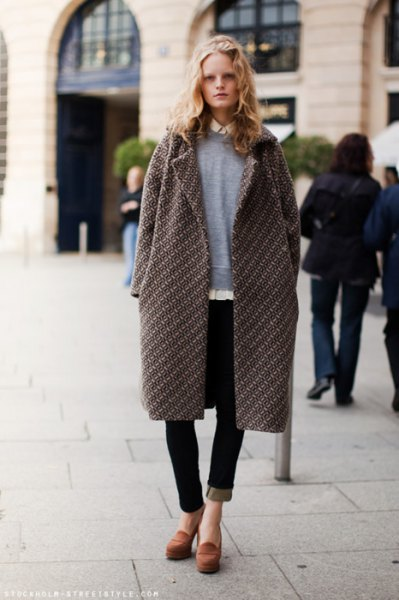 gray longline coat with sweater and black jeans