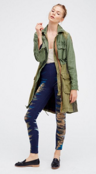 gray longline military jacket with dark blue leggings and slippers