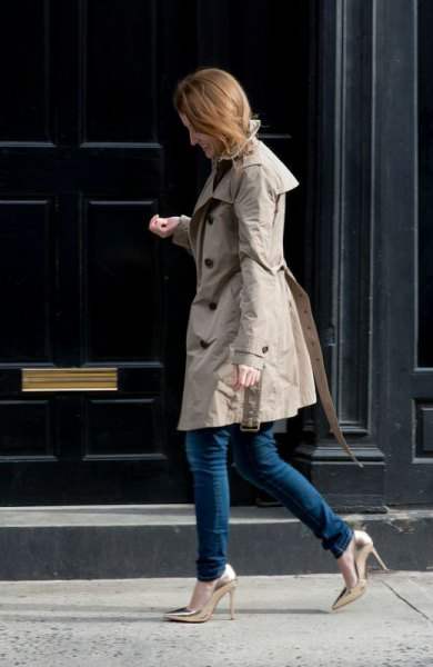 gray longline parka jacket with dark skinny jeans and gold heels