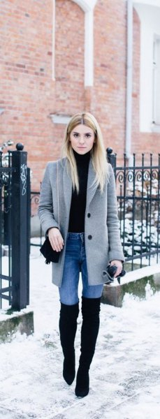 gray longline wool coat with light blue skinny jeans