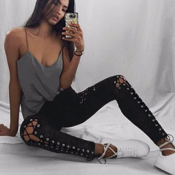 gray, low-cut top with spaghetti straps and black lace-up gaiters