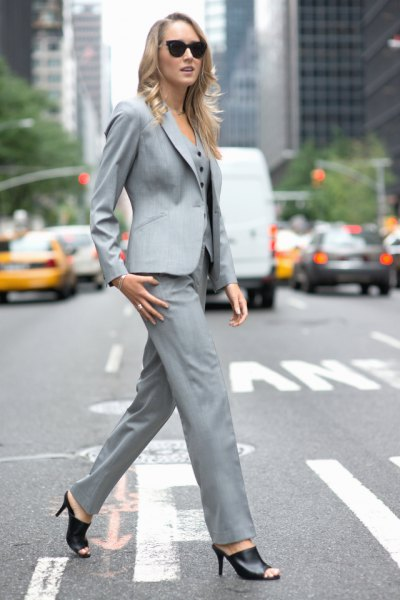 gray matching suit with black short open-toed boots