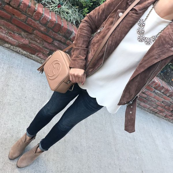 gray matte leather jacket with white shell blouse
