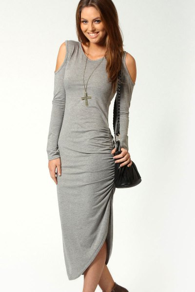 gray, figure-hugging dress with open shoulder and boots