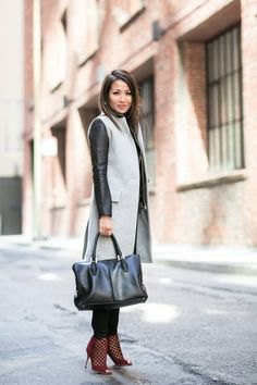 gray sleeveless wool coat in midi length over black leather jacket