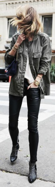 gray military jacket with black leather gaiters and studded boots