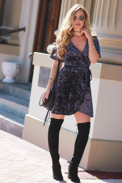 gray wrap dress made of mini velvet with black, thigh-high boots