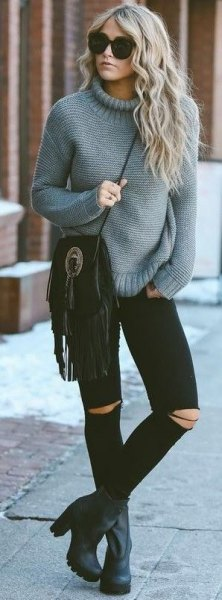 gray knitted sweater with mock neck and black skinny jeans