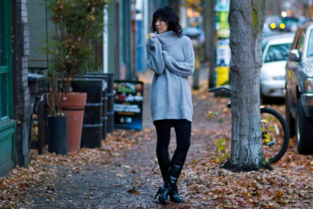 gray, chunky tunic sweater with mock neck, black leggings and knee-high leather boots