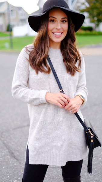 gray knitted sweater with false neckline, black floppy hat