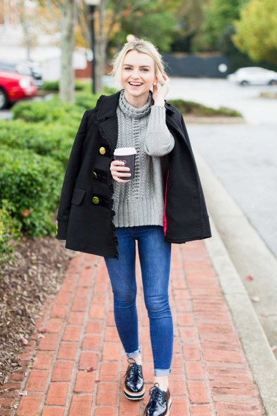 gray knitted sweater with stand-up collar and black double-breasted wool coat
