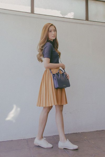 gray short-sleeved top with mock neck and orange skater miniskirt