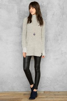 gray tunic sweater with mock neck and black leather gaiters