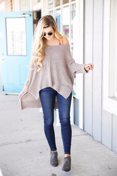 gray off shoulder slouchy sweater with dark blue skinny jeans
