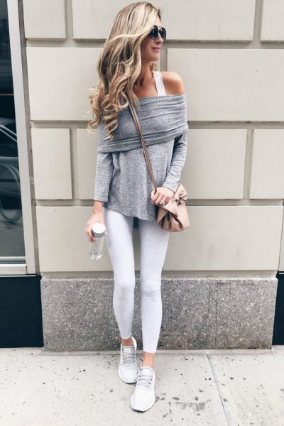 gray off the shoulder sweater with white tank top and sneakers