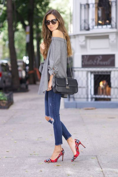 gray strapless blouse with blue ripped ankle jeans and checkered shoes