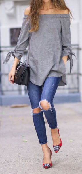 Shoulder-gray top with ripped jeans and red and black plaid flats