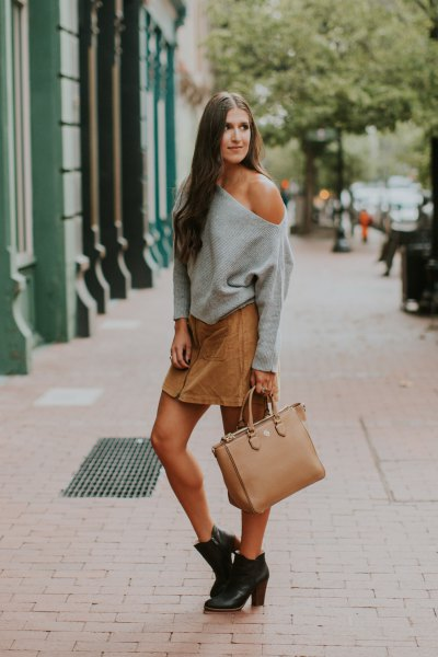 gray strapless sweater with a light brown mini skirt