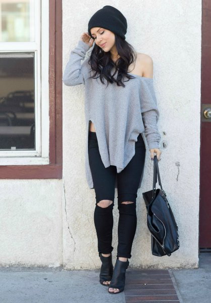 gray oversized sweater with one shoulder and black leather ankle boots