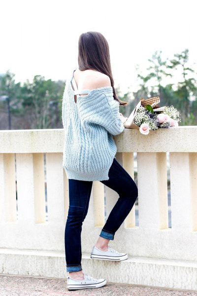 gray, strapless, ribbed, thick sweater with dark blue skinny jeans with cuffs