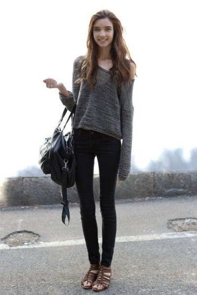 gray off the shoulder sweater with one shoulder and black skinny jeans